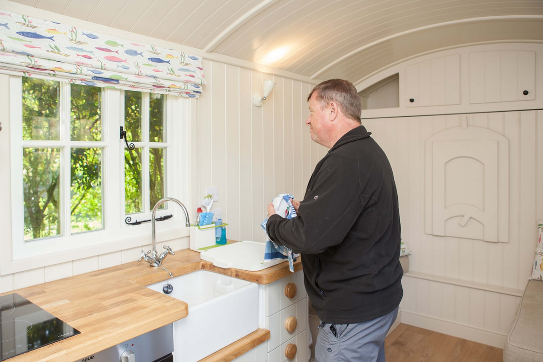 Doing the washing up in Mayfly Shepherd's Hut