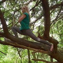 Yoga Teacher in a Tree